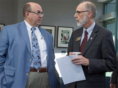 NIU President Doug Baker (right) chats with Dean L. Bartles, chief manufacturing officer of UI Labs and executive director of the Digital Manufacturing and Design Innovation Institute.