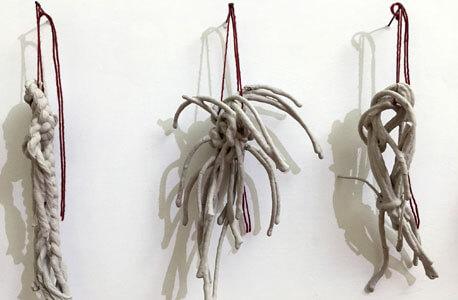 "Christine LoFaso: ""Fifty Knots."" Linen cord, clay slip, installation detail."