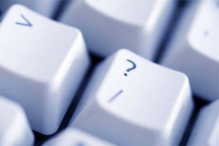 The question-mark key on a computer keyboard