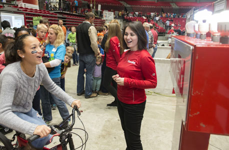 A STEMfest participant gets into the action on the exhibit that first inspired NIU student Sarah Derylo to dig deeper into her interest in science.