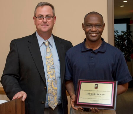 Graduate School Dean Bradley Bond with Professor Abu Bah, NIU's 2015 Outstanding International Educator.