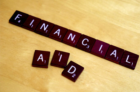 """FINANCIAL AID"" on Scrabble tiles"