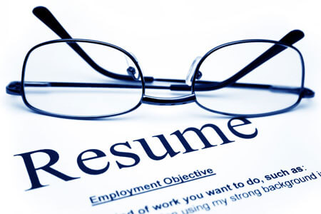 A pair of glasses on a resume