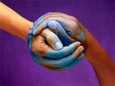 Hands combined to create globe