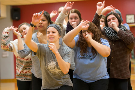 Members of the Harmelodics a cappella group rehearse for the ICCA quarterfinals.