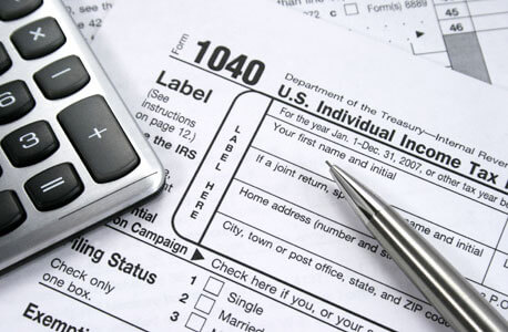 Federal 1040 form, pen and calculator