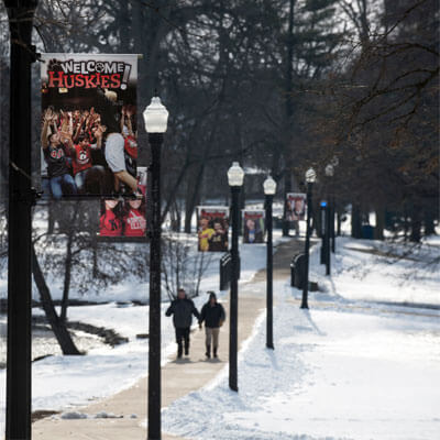 Signs on snowy NIU campus
