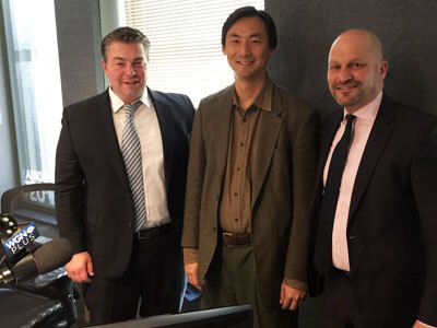 "WGN ""Legal Face-Off"" hosts Jason Whiteside (left) and NIU Law alumnus Rich Lenkov ('95, right) host NIU Law Professor Morse Tan (center) to discuss his new book on North Korea."