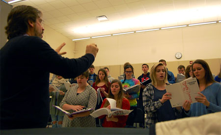 Eric Johnson rehearses choral students from Woodstock and Woodstock North high schools.