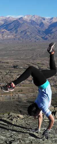 Student Danielle Dyra, happy to have reached the summit during a hike, pops a handstand.