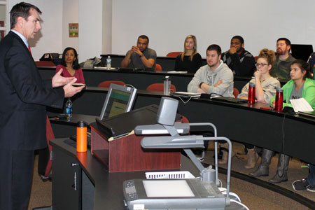 NIU Law alum Russell Slifer talks to current students in Swen Parson Hall.