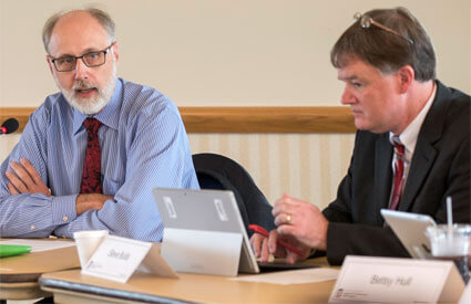 Supportive Professional Staff Council President Steve Builta listens to NIU President Doug Baker's comments during a September council meeting.