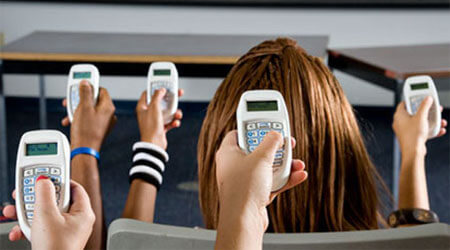 Photo of students holding clickers