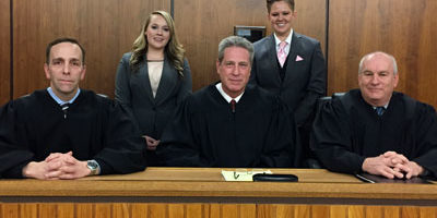The Moot Court champion team of second-year law students (standing from left) Chelsea Selvey and Stephanie Wiggins argued before the distinguished bench of (seated from left): Winnebago County Public Defender Nick Zimmerman ('00); the Honorable Joseph G. McGraw ('85), Chief Judge of the 17th Judicial Circuit of Illinois; and the Honorable Timothy J. McCann ('88), Presiding Judge in the Kendall County (IL) Circuit Court.