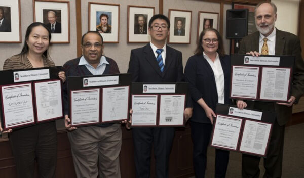 Professors (left to right) Lichuan Liu, Narayan Hosmane, Tao Xu and Elizabeth Gaillard, pictured here with President Doug Baker, were among those recognized for their work resulting in patents.