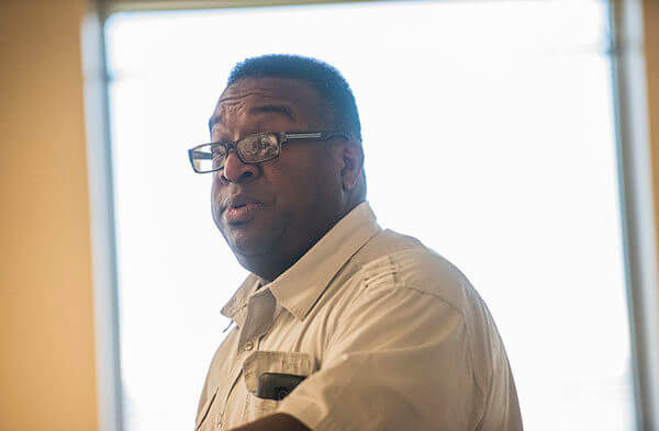 Black Faculty and Staff Association President William McCoy speaks to the group during a meeting in Barsema Hall on Aug. 22, 2016.