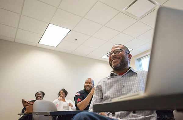 Black Faculty and Staff Association president-elect Joseph Flynn smiles during a meeting of the group in Barsema Hall on Aug. 22, 2016.
